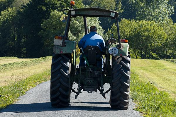 Image of a tractor on a country road